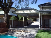 double-carport-matching-house-roof